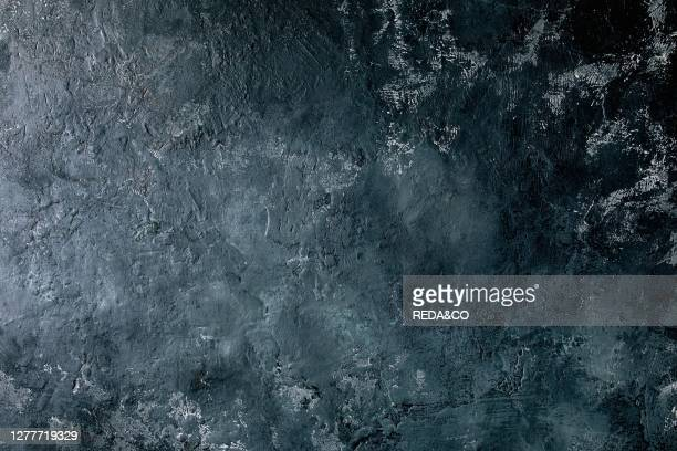Dark black stone concrete abstract background copy space.