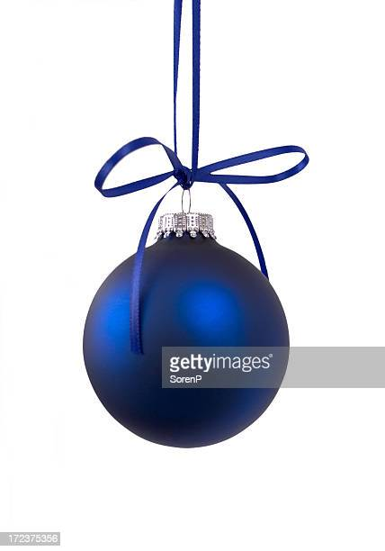 A dark blue Christmas bauble on a white background