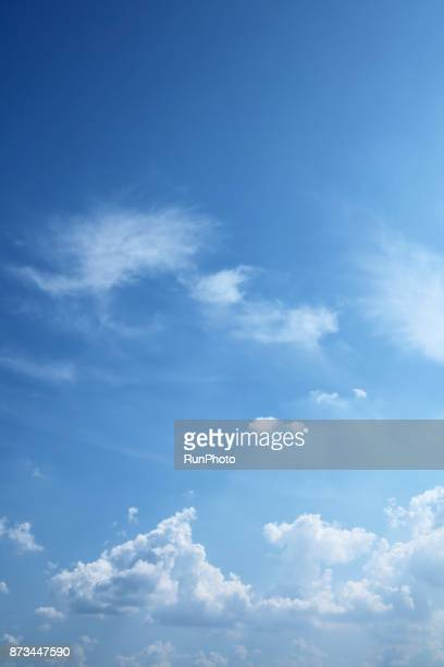 dark blue sky with lots of white clouds - vertical stock pictures, royalty-free photos & images