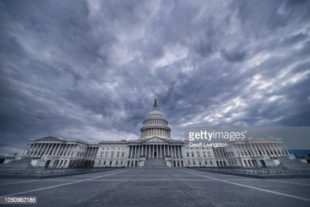 dark capitol ominous version - us capitol building stock pictures, royalty-free photos & images