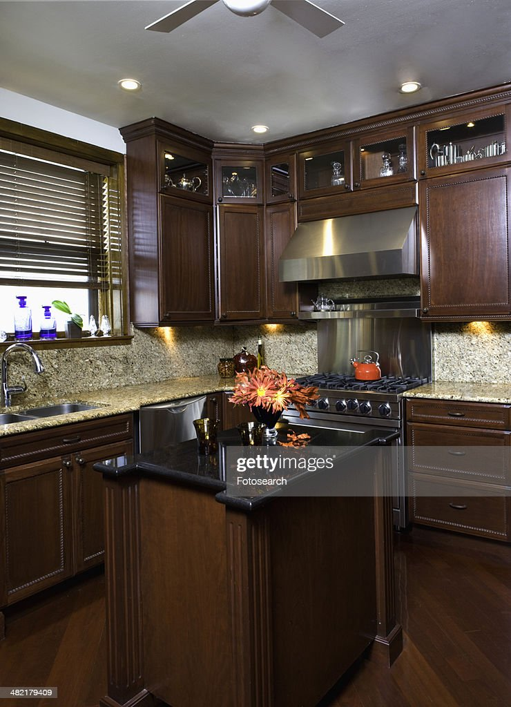Dark Cherry Stained Cabinets In A Kitchen High-Res Stock ...