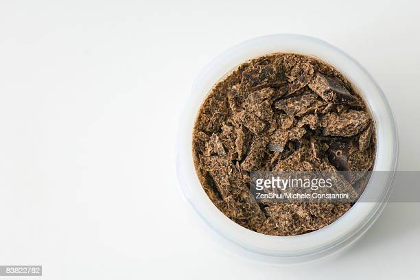 Dark chocolate in small container, close-up