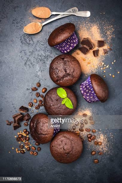 dark chocolate muffins on black background - チョコレートチップマフィン ストックフォトと画像