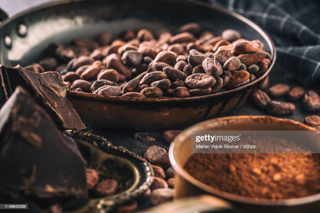 Dark Chokolate Cocoa Beans And Powder On Concrete Table : Stock Photo