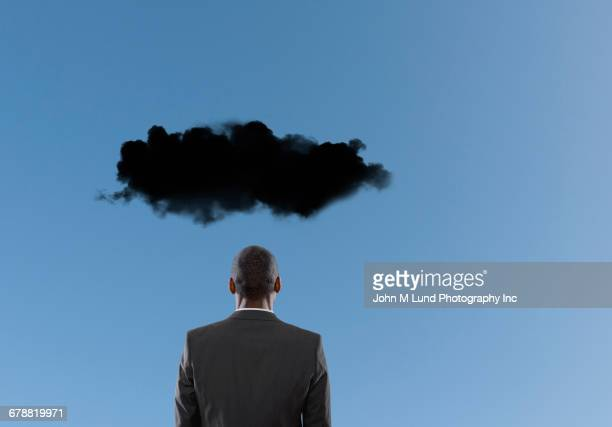 Dark cloud over Mixed Race businessman