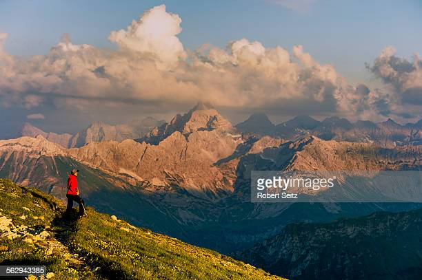 dark clouds above the allgau alps with mountain hiker, oberstdorf, bavaria, germany - oberstdorf stock pictures, royalty-free photos & images