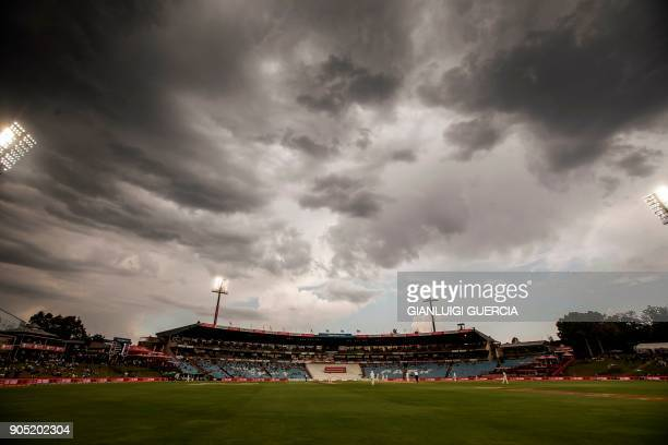 Dark clouds are seen above the cricket field during the third day of the second Test cricket match between South Africa and India at Supersport...