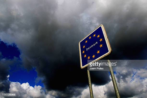 Dark clouds are seen at the GermanDanish border on May 13 2011 near Flensburg Germany Denmark has introduced border controls at its borders to...