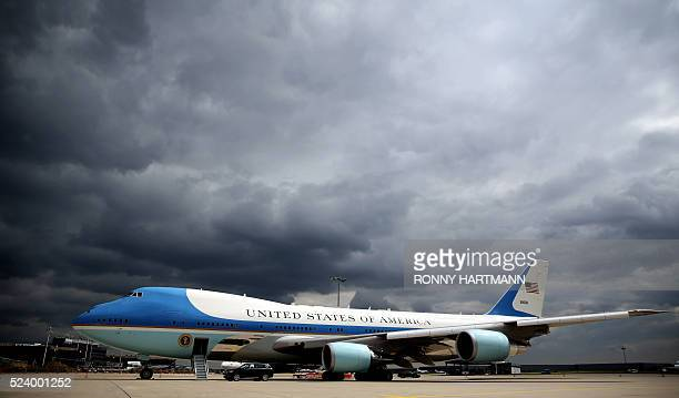 Dark clouds are seen behind the Air Force One on the tarmac at the airport Langenhagen near Hanover central Germany on April 25 2016 Obama is in...