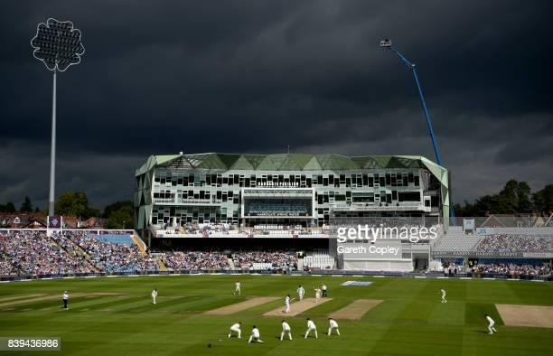 Dark clouds as Stuart Broad of England runs into bowl during day two of the 2nd Investec Test between England and the West Indies at Headingley on...