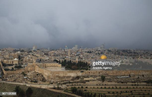 Dark clouds cover the city ahead of a rainfall in Jerusalem on January 19 2018