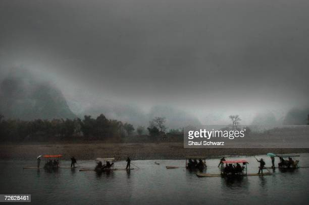 Dark clouds cover the landscape of towering karst formations surrounding the Li River on February 09 2004 in the south of China Notorious for its...