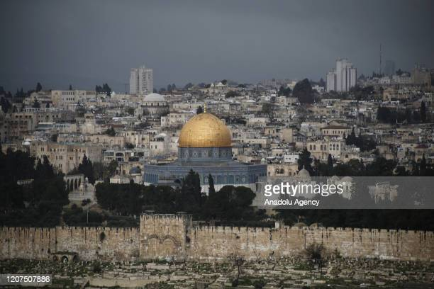 Dark clouds cover the sky over Kubbet'us-Sahra in Jerusalem before a rainfall on March 17, 2020.