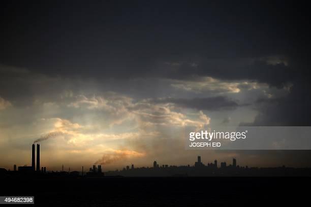 Dark clouds form over the Lebanese capital Beirut on October 28 2015 AFP PHOTO / JOSEPH EID