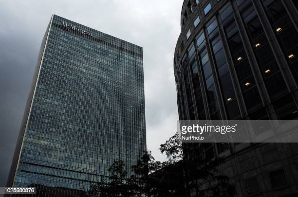 Dark clouds gather behind the European headquarters of investment bank JP Morgan, formerly European home of Lehman Brothers, in the Canary Wharf...