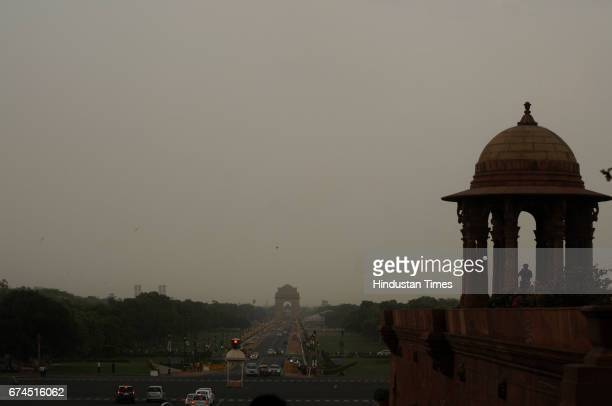 Dark clouds gather over Rashtrapati Bhavan before a sudden downpour on April 28 2017 in New Delhi India