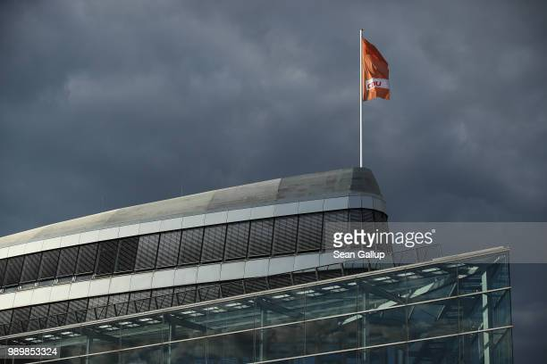 Dark clouds hang behind the party headquarters of the German Christian Democrats where inside party leader and German Chancellor Angela Merkel was...