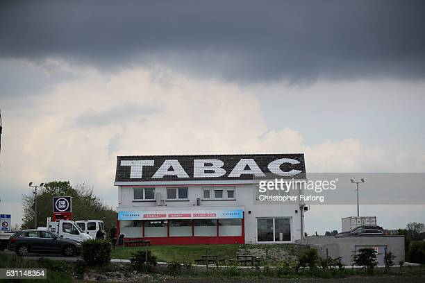 Dark clouds hang over discount tobacco shop catering for cross border travellers on May 10 2016 in Adinkerke Belgium The Schengen Agreement which led...