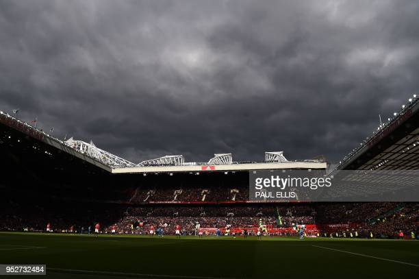 TOPSHOT Dark clouds hang over Old Trafford during the English Premier League football match between Manchester United and Arsenal at Old Trafford in...