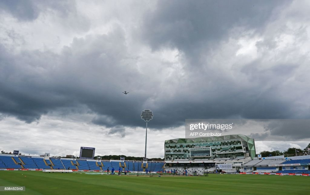Dark clouds hang over the ground during a West Indies nets practice session at Headingley cricket ground in Leeds, northern England on August 24, 2017, ahead of their second Test match against England. / AFP PHOTO / Lindsey PARNABY / RESTRICTED