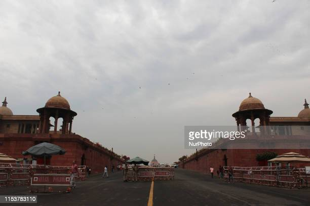 Dark clouds loom over the Rashtrapati Bhavan during light rain in New Delhi on July 4, 2019. The Indian capital received pre monsoon showers bringing...