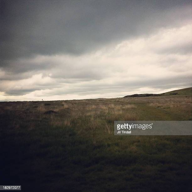 dark clouds looming over moorland