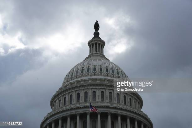 Dark clouds move over the Statue of Freedom on top of the US Capitol Dome May 14 2019 in Washington DC