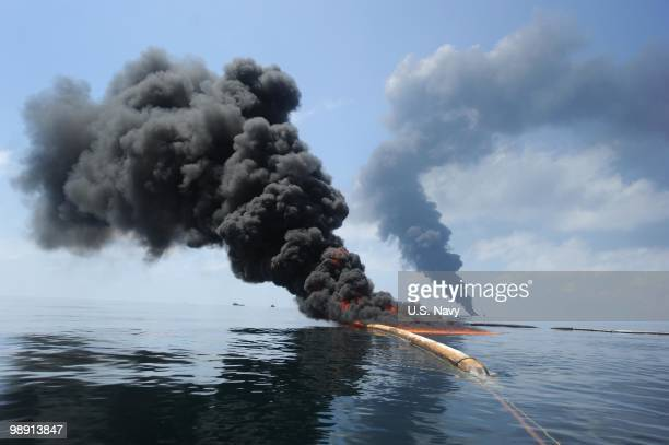 Dark clouds of smoke and fire emerge as oil burns during a controlled fire in the Gulf of Mexico The US Coast Guard working in partnership with BP...