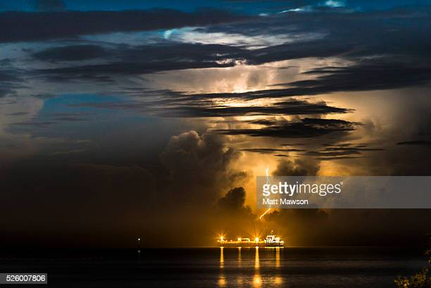 Dark Clouds, orange lightning and Stormy Weather off the Pacific Coast of Mexico