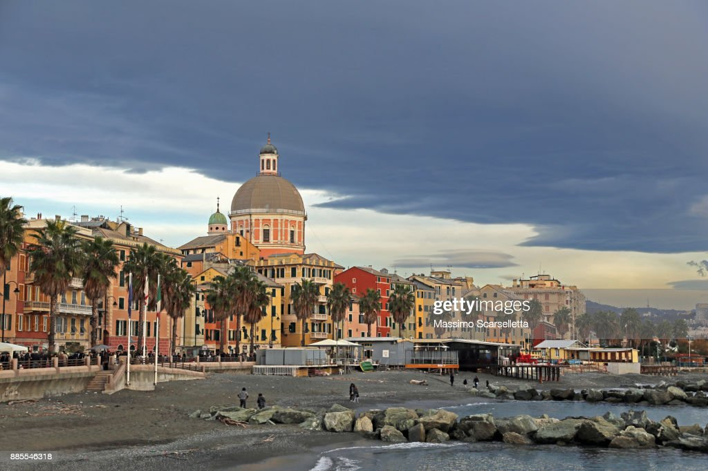 Dark Clouds Over A Blue Sky Along The Promenade Of Genova Pegli. : Stock  Photo