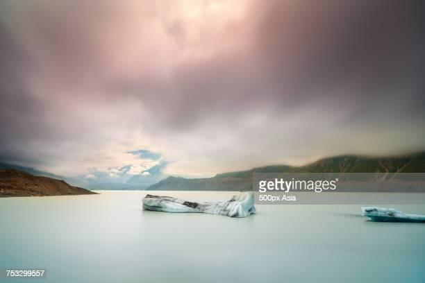 Dark clouds over Hooker Glacier Lake in front of Mount Cook, New Zealand