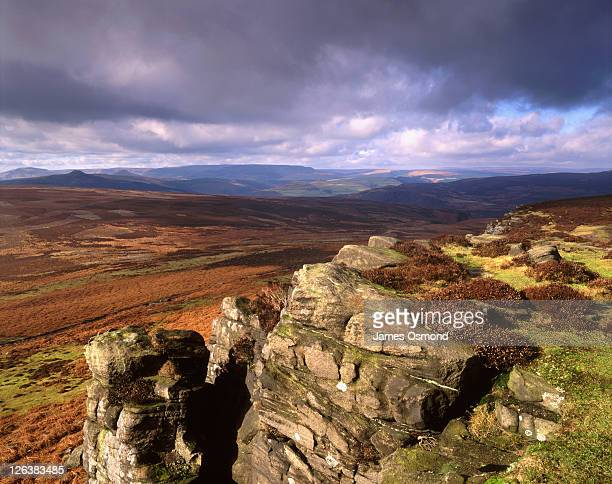 dark clouds over stanage edge in the peak district national park. - east stock pictures, royalty-free photos & images