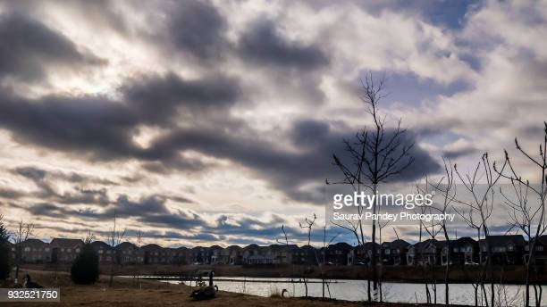 Dark clouds over suburbian houses
