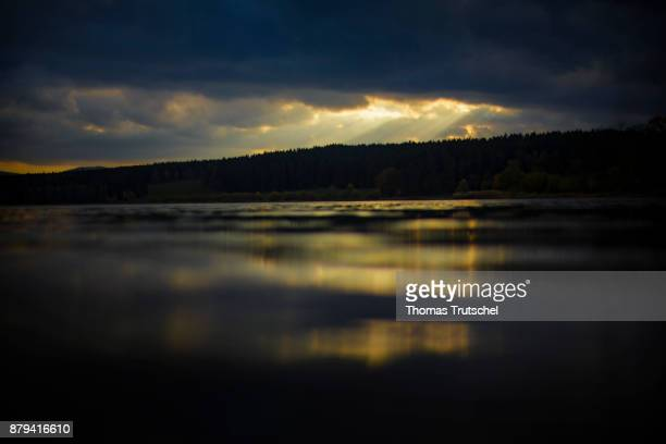 Dark clouds pass over a lake in the evening on November 02 2017 in Heyda Germany