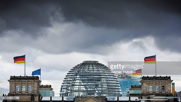 Dark clouds pass over the dome of the Reichstag on November 02 2016 in Berlin Germany
