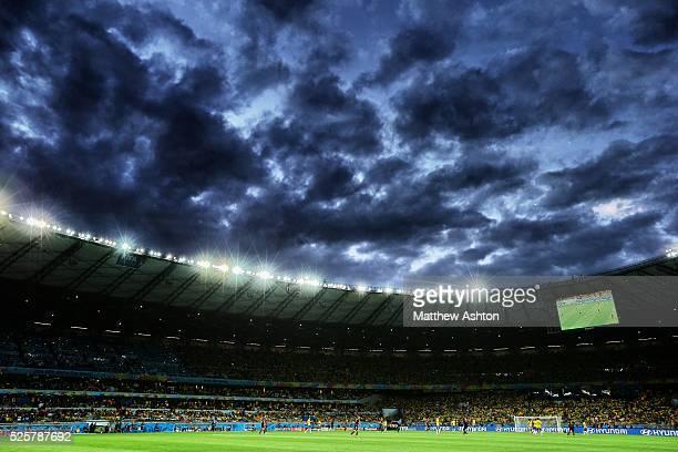 Dark clouds roll over the The Belo Horizonte FIFA World Cup Stadium in Brazil also known as Estadio Governador Magalhaes Pinto Mineirao / Toca da...
