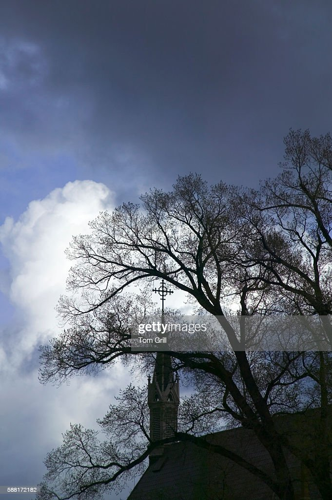 Dark Clouds Rolling over a Church : Stock Photo