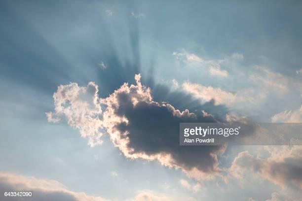 Dark Clouds, Sun and Blue Sky Behind