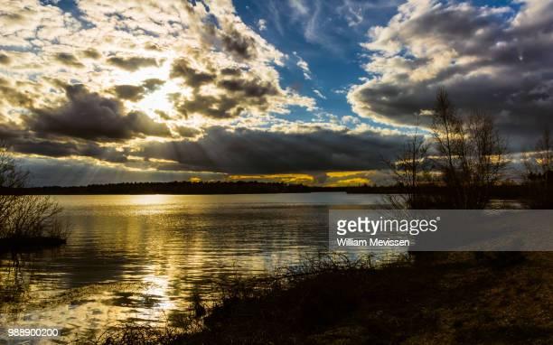 dark cloudy sunset - william mevissen bildbanksfoton och bilder