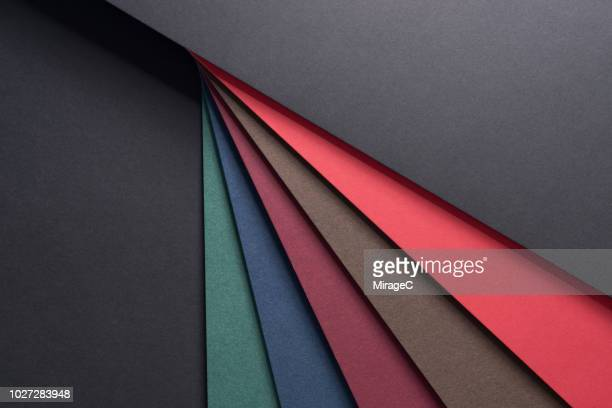 dark color paper stacking - tilt stock pictures, royalty-free photos & images