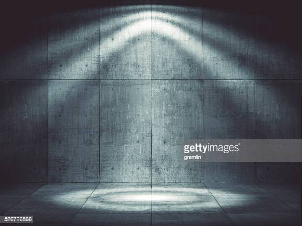Dark concrete environment with top illumination