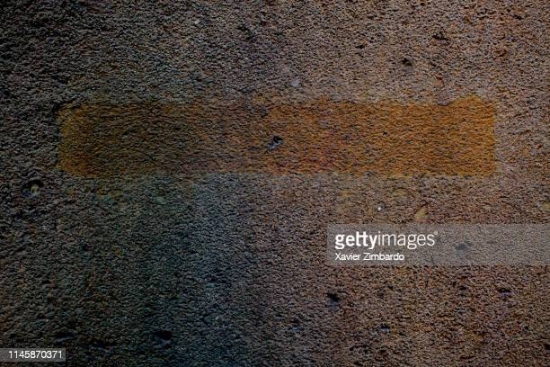 Dark concrete texture background of a wall with a line