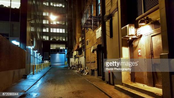 Dark dead end alley in Lower Manhattan at night, New York City