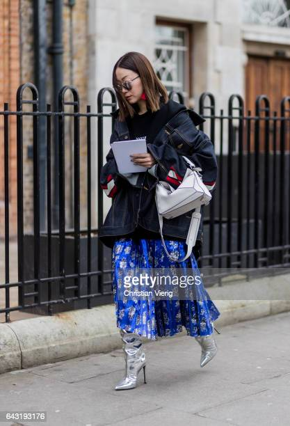 A dark denim jacket blue skirt silver boots outside Anya Hindmarch on day 3 of the London Fashion Week February 2017 collections on February 19 2017...