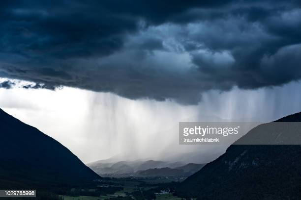 dark downpour - torrential rain stock pictures, royalty-free photos & images