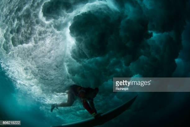 Dark duckdive surfer