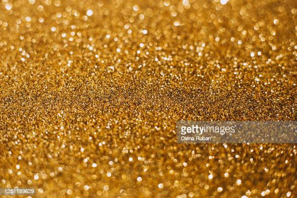 dark golden blur colored bokeh close-up, free place - rondas deportivas fotografías e imágenes de stock