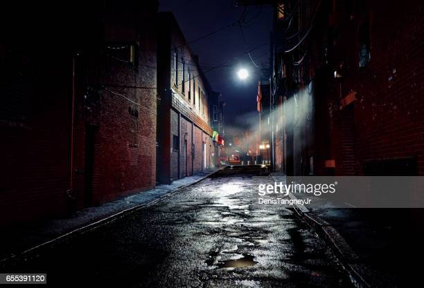 dark gritty alleyway - high street stock pictures, royalty-free photos & images