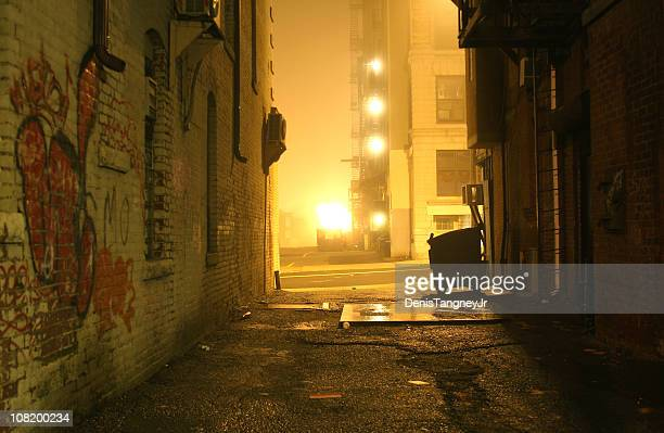 dark grunge alley with lights shining at night - alley stock pictures, royalty-free photos & images