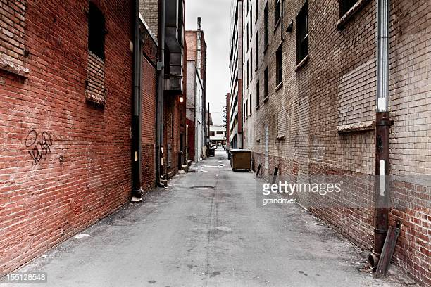 dark grungy alley - alley stock photos and pictures